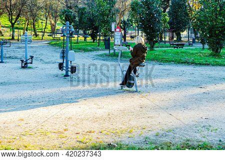 Vigo, Spain - 18 January 2021: Woman Doing Sports In A Biosaludable Park