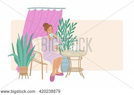 Woman In A Bathrobe Drinks Herbal Tea In A Spa Salon After A Massage, A Healthy Drink, Table With A