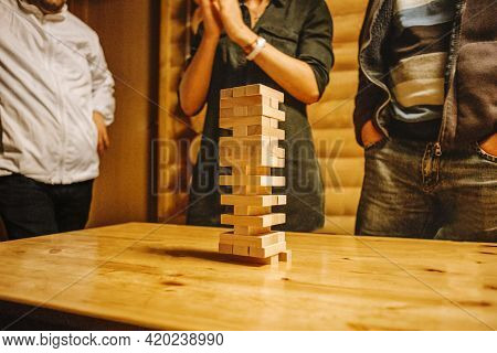 Wooden Stick Tower Board Game, A Group Of Young Friends Play Wooden Stick Tower Board Game, A Great