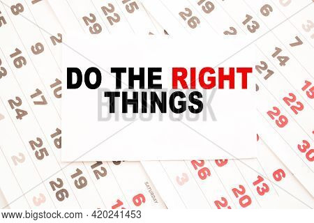 Notepad With Text Do The Right Things On The Office Desk With Stationery. A Blank Notepad For Enteri