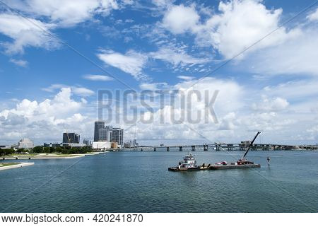 The View Of A Construction Platform With A Crane Drifting In Miami Harbor Under The Picturesque Clou