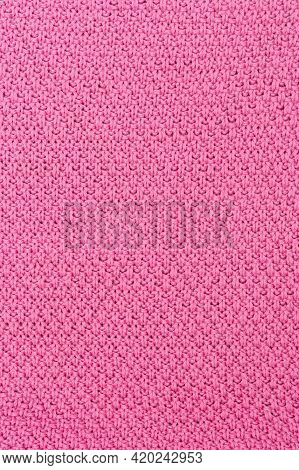 Pink Knitted Fabric Pearl Woolen Background. The Structure Of The Fabric With A Natural Texture. Fab