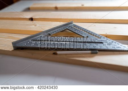 Miercurea Ciuc, Romania- 12 May 2021: Swanson Metric Speed Square On Pine Wood Boards In A Small Woo
