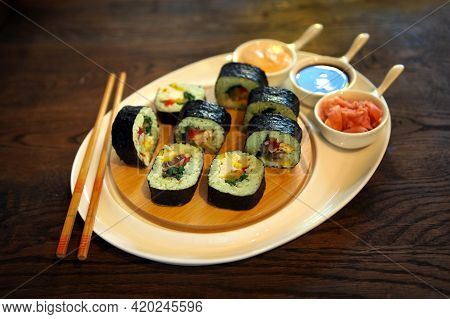 Sushi Rolls With Soy Sauce. Roll Set Sashimi Japanese Food On Wooden Background Roll Set Sashimi Jap
