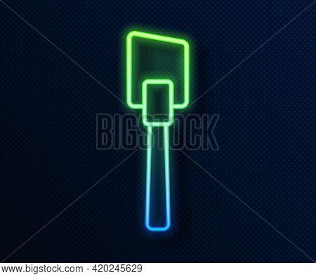 Glowing Neon Line Spatula Icon Isolated On Blue Background. Kitchen Spatula Icon. Bbq Spatula Sign.