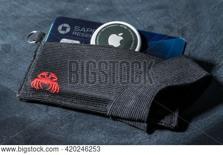 Morgantown, Wv - 12 May 2021: Apple Airtag Device Inserted Into The Small Credit Card Wallet To Trac