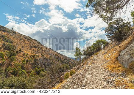 Scenic Landscape In The Mountains, Cloudy Sky And Mountain Slopes. Brac Island, Croatia.