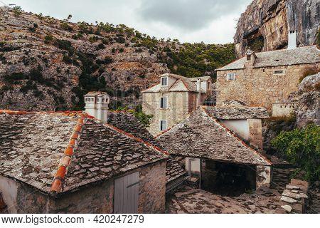 Stone Houses Of Pustinja Blaca Hermitage, Monastery On The Brac Island, Croatia.