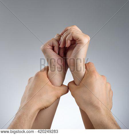 Male Hands Grabbed Female Hands. Violence Concept