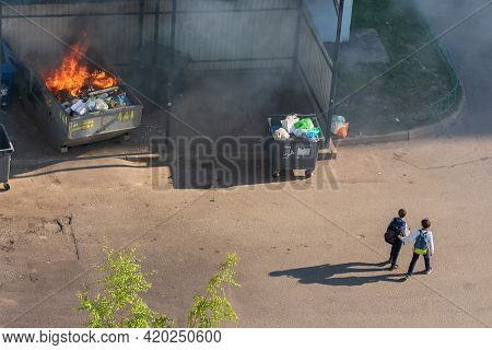 Balashikha, Russia - May 11, 2021: Burning Rubbish In A Container. Burning Garbage.