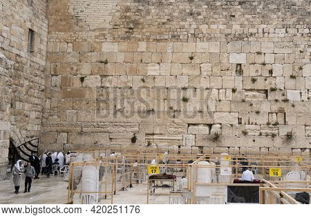 Jerusalem, Israel - April 3rd, 2021: A Jewish Prayer At The Western Wall Of The Temple Mount, In The