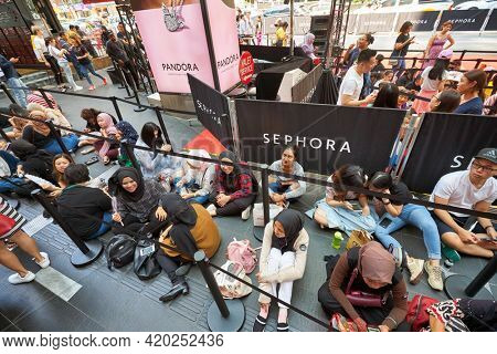 KUALA LUMPUR, MALAYSIA - JANUARY 18, 2020: people sit in line waiting for the grand opening of Sephora store at Fahrenheit 88 shopping mall in Kuala Lumpur.