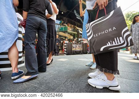 KUALA LUMPUR, MALAYSIA - JANUARY 18, 2020: a person stand with Sephora branded shopping bag on Sephora grand opening day at Fahrenheit 88 shopping mall in Kuala Lumpur.