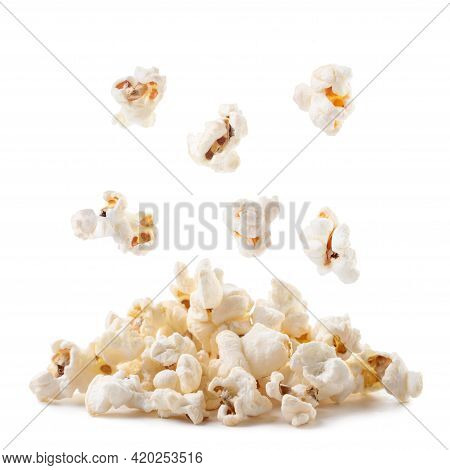 Popcorn Falls On A Heap Close-up On A White Background. Isolated