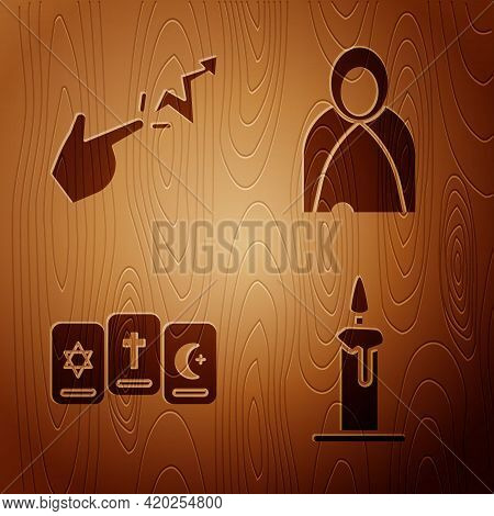 Set Burning Candle In Candlestick, Spell, Three Tarot Cards And Mantle, Cloak, Cape On Wooden Backgr