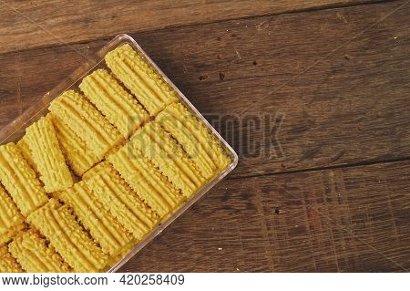 Malaysian Traditional Cookies Called As Kuih Semperit On Wooden Plate Served During Eid Fitri