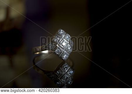 Close Up Of Elegant Silver Designer Ring Isolated On Dark Black Background. 3d Jewelery Object; Extr