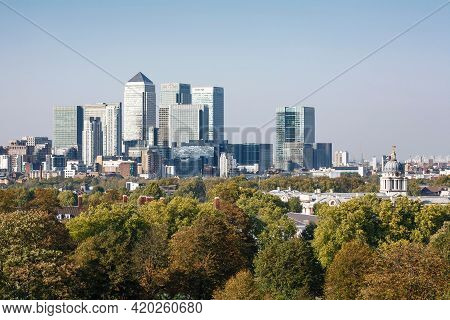 London, Uk - October 03, 2011. Green Spaces. Central London Uk City Skyline With Trees And Canary Wh