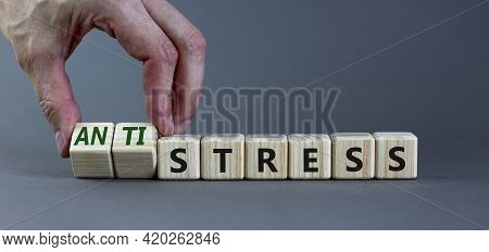 Antistress Vs Stress Symbol. Doctor Turns Cubes, Changes The Word Stress To Anti Stress. Beautiful G