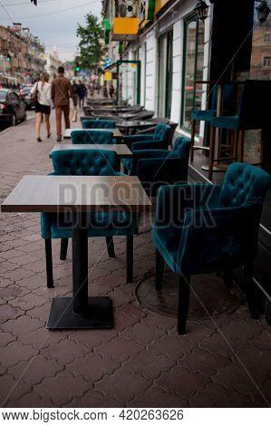 Interior Of A Summer Open-air Cafe. Summer Outdoor Cafe Terrace. Street Cafe. Cozy Outdoor Restauran