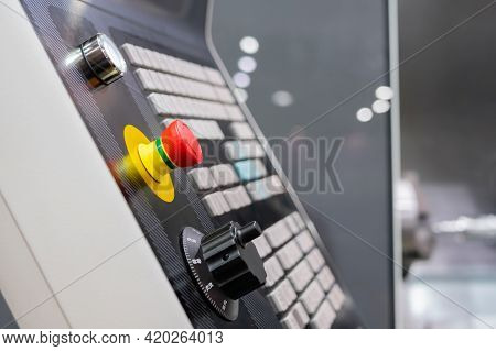 Control Panel Of Cnc Turning Milling Lathe Machine At Factory, Plant, Red Emergency Switch Button On