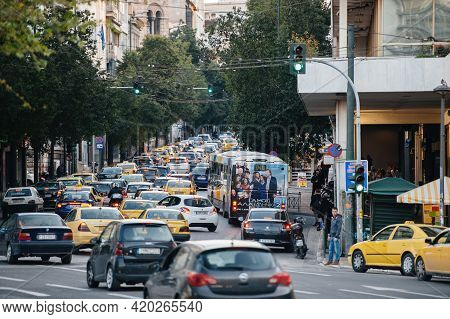 Athens, Greece - Mar 29, 2016: Busy Lanes With Yellow Taxis And Cars On The Ploutarchou Avenue In Ce