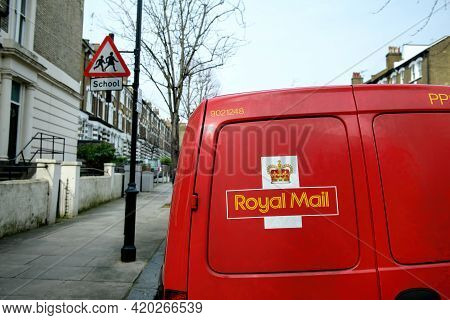 London, United Kingdom - Mar 11, 2017: Red Van With Royal Mail Logotype In A Calm Neighborhood
