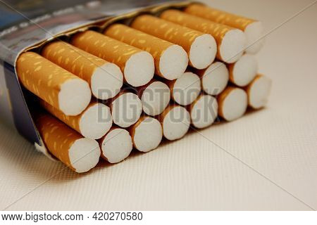A Pack Of Cigarettes On A White Background. Open Pack Of Cigarettes. Yellow Filter. Harm To Health.