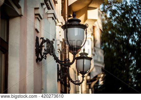 Street Vintage Lantern. Vintage Street Lamps. Iron Lantern. Garden Lanterns On The Wall With Sunligh
