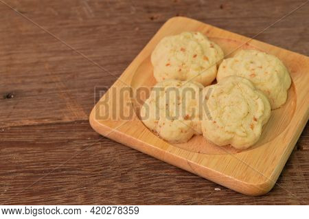 Malaysian Traditional Cookies Called As Kuih Bangkit Cheese On Wooden Plate Served During Eid Mubara