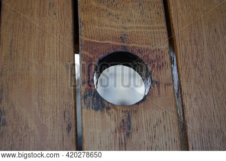 A Round Hole In A Wooden List