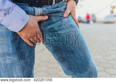 Low Section View Of Persons Wet Jeans Standing On Carpet.