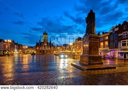 Delft City Hall and Delft Market Square Markt with Hugo de Groot Monument in the evening. Delfth, Netherlands