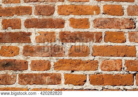 Background, Texture. Fragment Of Old Red Brick Masonry With Joining On White Cement Mortar.