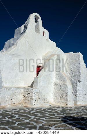 Famous tourist landmark of Greece - Greek Orthodox Church of Panagia Paraportiani in town of Chora on Mykonos island, Greece on sunrise