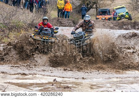 Afipsip, Russia - October 31, 2020: Sportsmen On Brp Can-am Quad Bikes Drive Splashing In Dirt And W