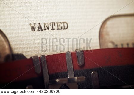 The word wanted written with a typewriter.