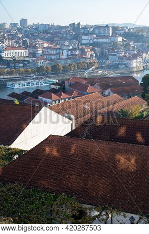 Panoramic View On Old Part Of Porto And Porto Loges Of Vila Nova De Gaia In Portugal At Sunrise