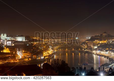 Panoramic View On Old Part Of Porto City In Portugal At Night