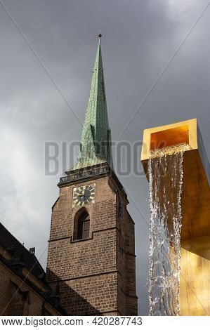 Pilsen, Czech Republic, 1.09.2019 - Futuristic Golden Fountains With View Of Cathedral Spire. Journe