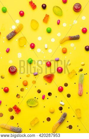 Candy Layout On A Yellow Background . Copy Space Candy. An Article About Sweets. Marmalade Candies.