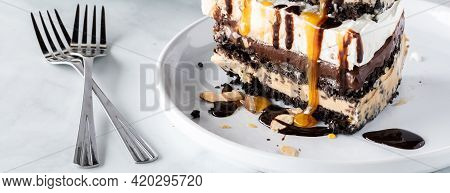 Close Up Narrow View Of A Slice Of Chocolate And Mocha Flavoured Ice Cream Pie With Caramel And Choc