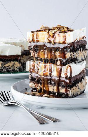 A Straight On View Of Two Slices Of Chocolate And Mocha Flavoured Ice Cream Pie Stacked On Top Of Ea