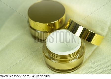 Mockup Empty Luxury Golden Two Cream Jars On Brown Fabric Folds Background, Selective Focus At Edge