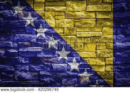 National Flag Of Bosnia Herzegovina On Stone  Wall Background.the Concept Of National Pride And Symb