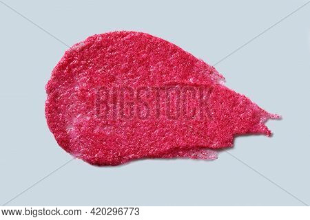 Smear Of Exfoliating Scrub With Berry And Sugar On Gray Background. Close-up