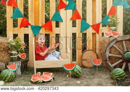 Smiling Little Boy. Beautiful Child Having Picnic In Summer. Caucasian Boy Enjoying Watermelon. Todd