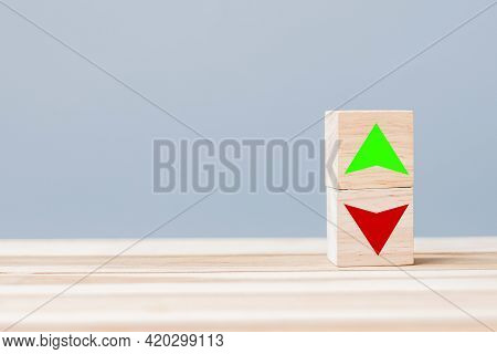 Wood Cube Block With Up And Down Arrow Symbol Icon On Table. Interest Rate, Stocks, Financial, Ranki