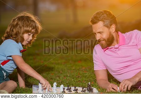 Father And Son Playing Chess Spending Time Together Outdoor. Men Like Chess Game. Male Generation Po