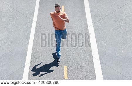 Man Running On Country Road, Sport Motivation Training. Runner Or Jogger Concept.